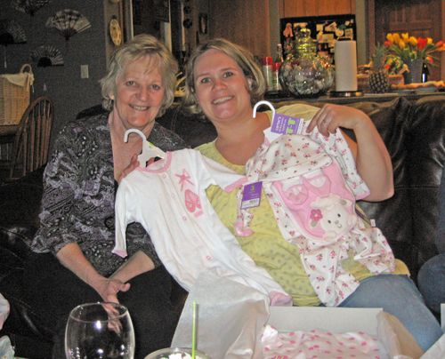 Grandma to be (Jane, Darrin's mom) and me opening gifts